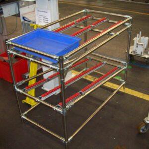 Desserte fixe avec convoyeur à galets pour bacs - Mobilier & Aménagement industriel - METALINOX 1